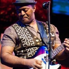Donne Roberts plays guitar in famous rock opera band